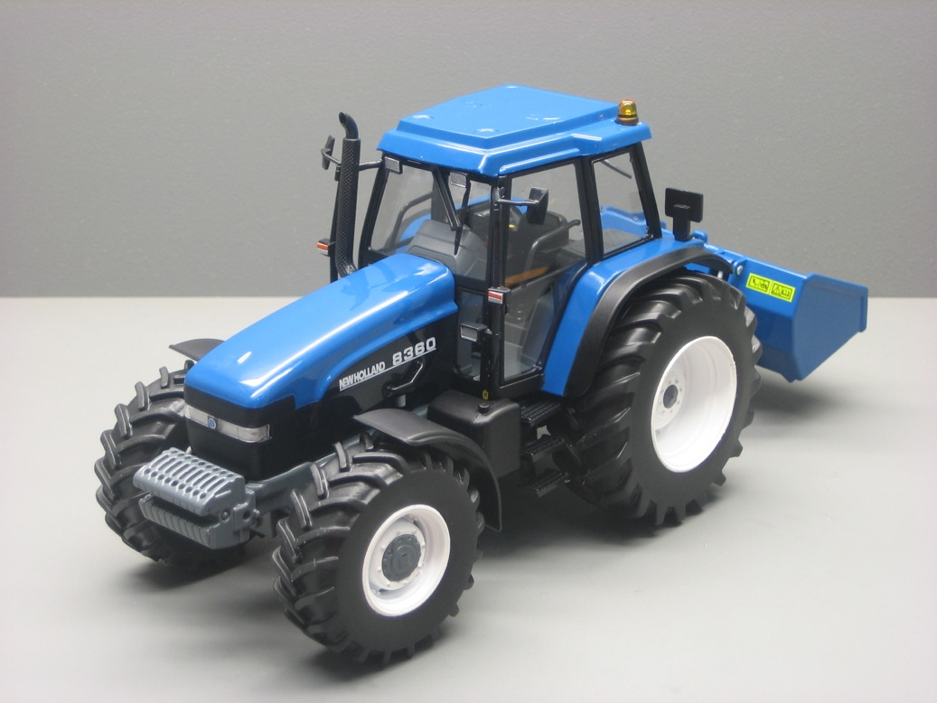NEW HOLLAND  8360 + Godet hydraulique bleu